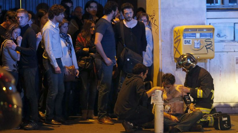 a-member-of-the-french-fire-brigade-aids-an-injured-individual-near-the-bataclan-concert-hall-following-fatal-shootings-in-paris_5463096